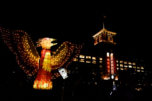 An orange and red illuminated Phoenix began the parade as it passed by Ponce City Market.