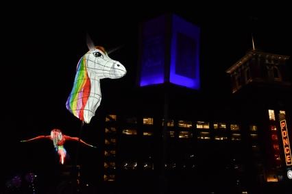 A unicorn and parrot lantern.