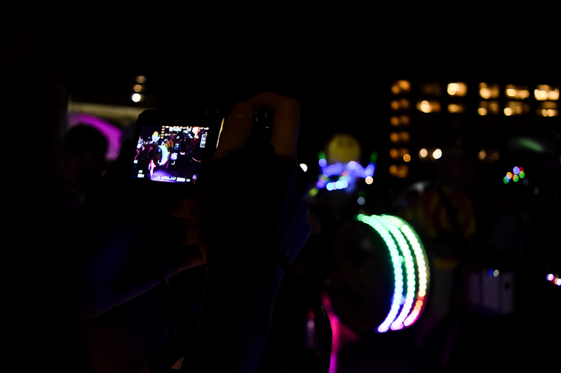 A photo of another photographer's camera screen as she takes pictures of the parade.