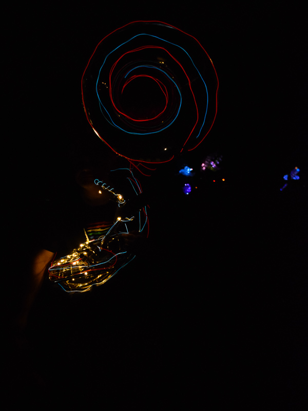 A tuba decorated with red and blue lights around the horn.
