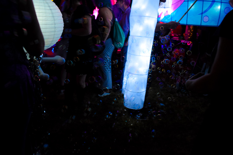 Bubbles are illuminated by the light of the lanterns.